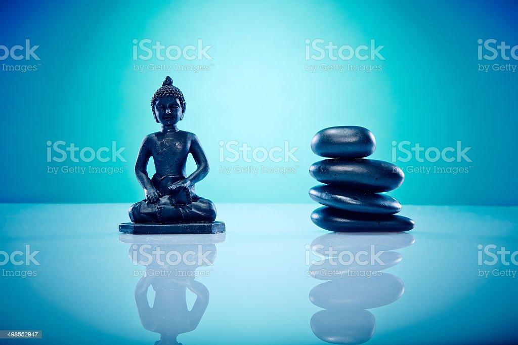 Buddah and hot stones stock photo