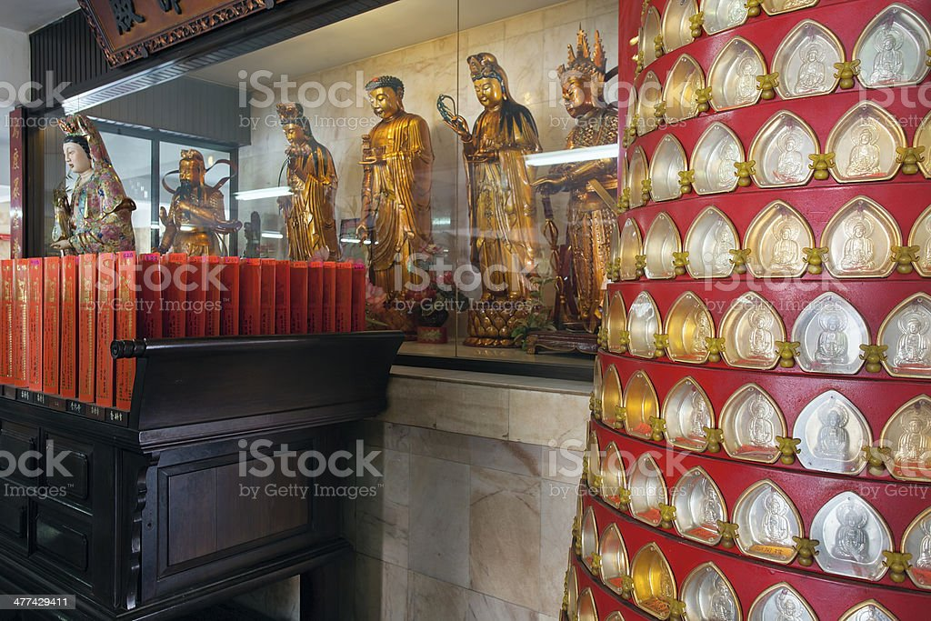 Buddha Amulets and Statues at Chinese Temple stock photo