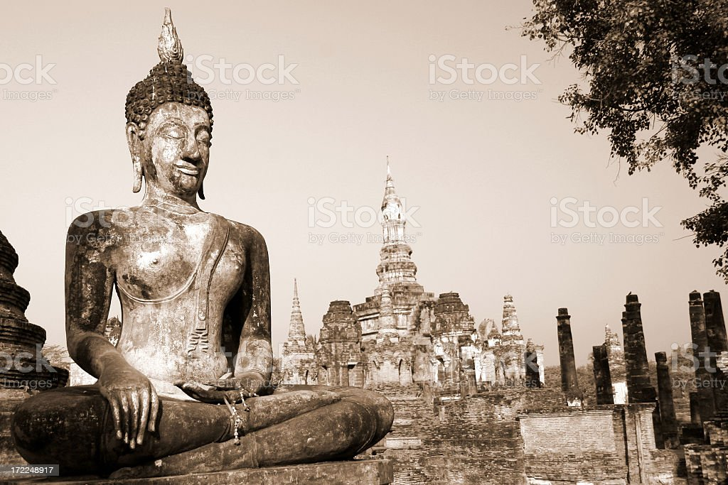 Buddha and Buddhist Temple in Sukhothai at Sunrise stock photo