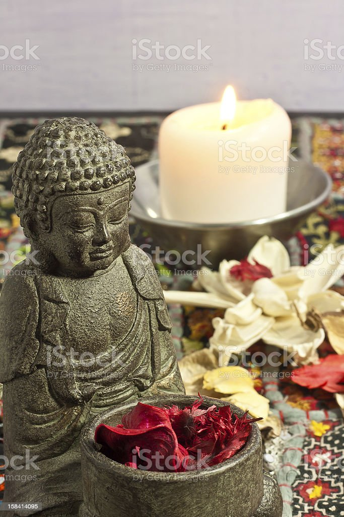 Buddha and candles royalty-free stock photo