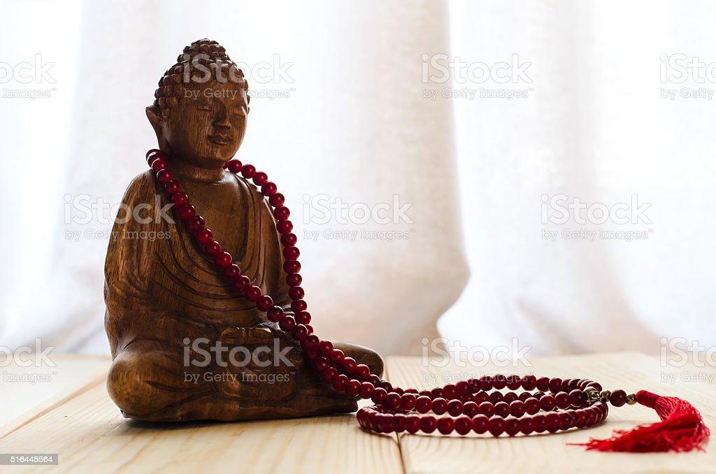 Buddha and mala beads stock photo