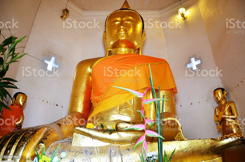 Buddha at Wat Phra Borommathat Chaiya Temple stock photo