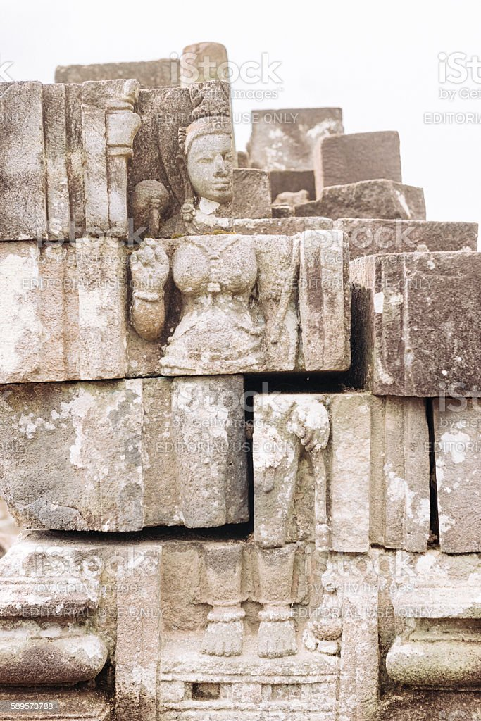 Buddha Bas Relief Stone Carving in Ancient UNESCO Temple Java stock photo