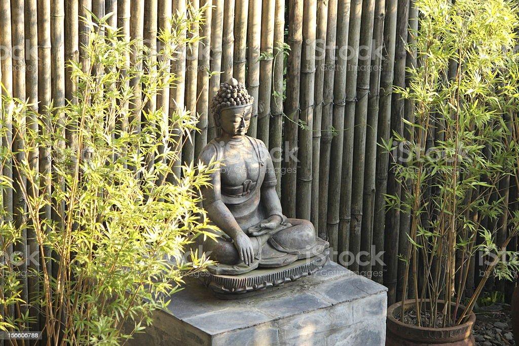 Buddha between bamboos stock photo