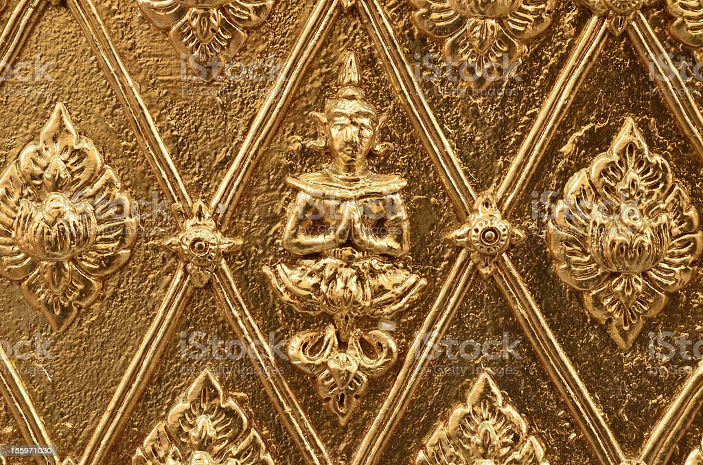 Buddha carved gold wall royalty-free stock photo