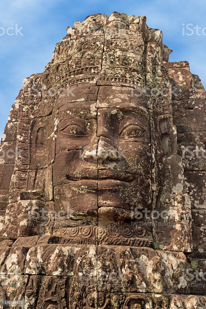 Buddha face carved in stone stock photo