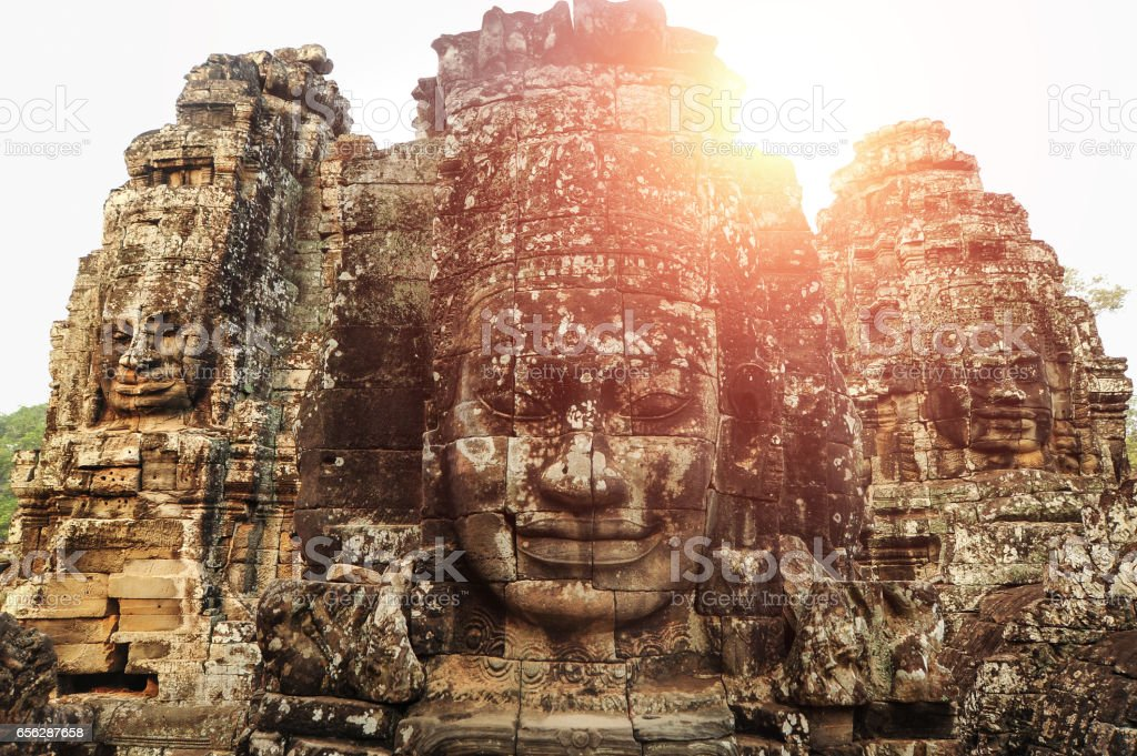 Buddha Face Carved On Stone At Angkor Wat Temple,Cambodia stock photo