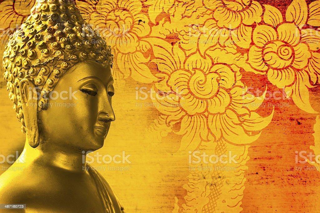 Buddha gold statue on golden background patterns Thailand. stock photo