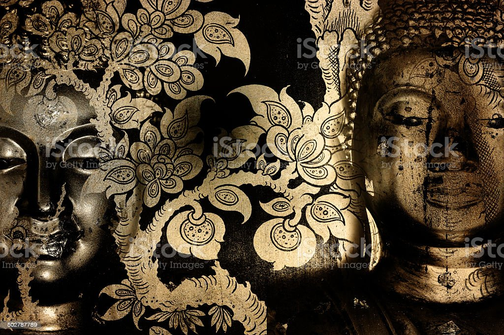 Buddha gold statue on golden background patterns Thailand. royalty-free stock photo