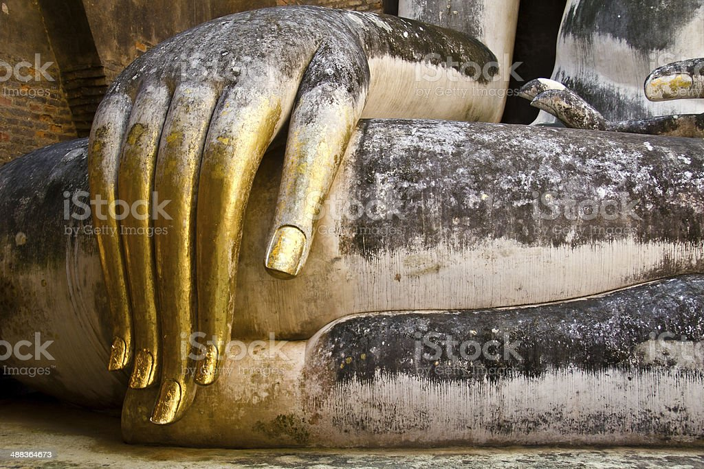 Buddha hand with gold leaf in Sukhothai, Thailand stock photo