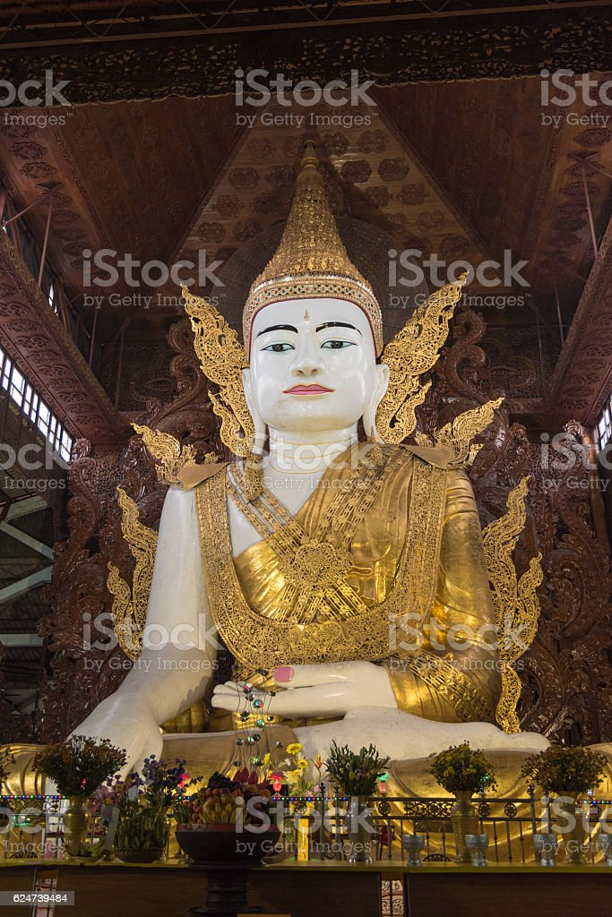 Buddha image in Ngahtatgyi temple stock photo