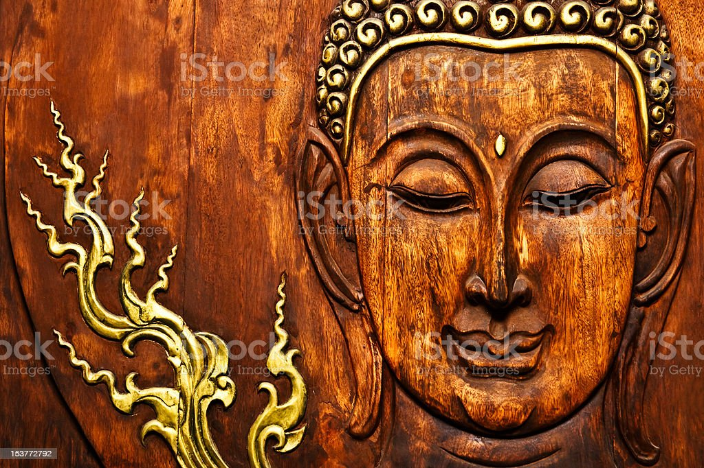 Buddha image in Thai style wood carving royalty-free stock photo
