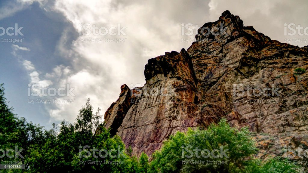 Buddha image on rock over Kar Gah river, Karakorum, Pakistan stock photo