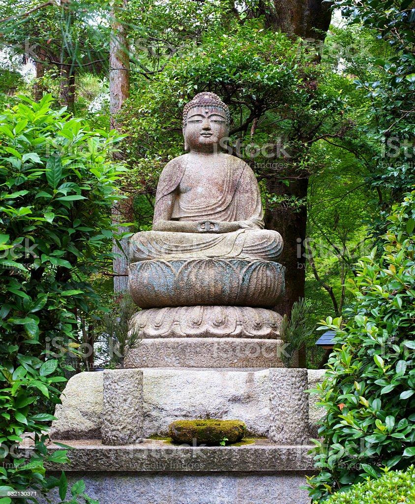 Buddha in Japanese Garden stock photo