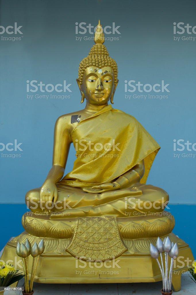 Buddha on a blue background stock photo
