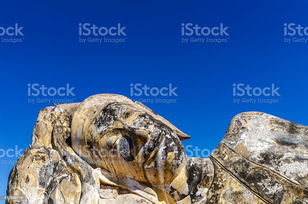 Buddha relaxing in Ayutthaya close-up pure deep blue clear sky stock photo
