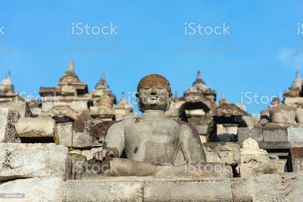 Buddha Scultures in Ancient Indonesian Borobudur UNESCO Buddhist Temple stock photo