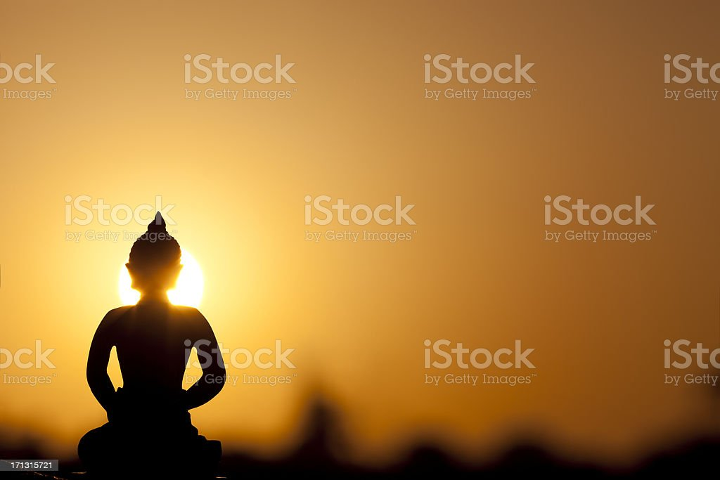buddha silhouette and real sunrise stock photo