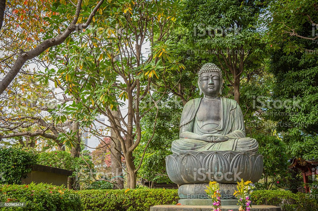Buddha sitting on lotus flower in Sensoji temple , Tokyo stock photo