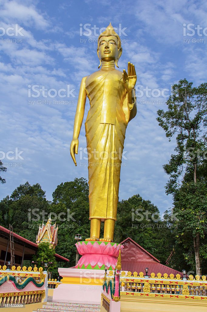Buddha standing in temple stock photo