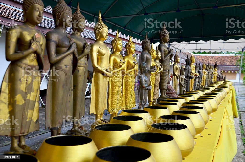 Buddha statue and Alms-bowl of monk for people donation stock photo