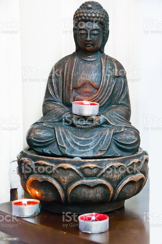 Buddha statue and candles stock photo