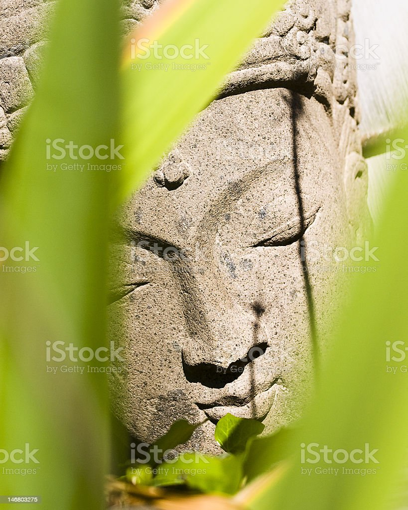 Buddha Statue and Palm Leaves royalty-free stock photo