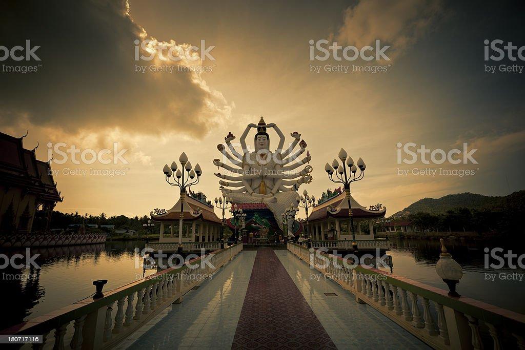 buddha statue at sunset stock photo