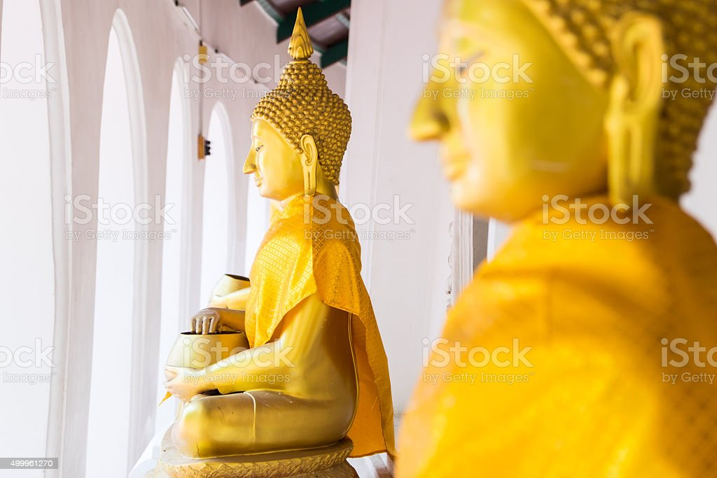 Buddha statue at Wat Phra Pathom Chedi stock photo