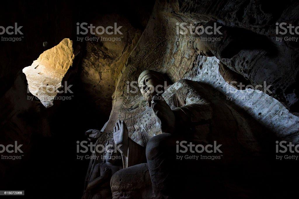 Buddha statue at Yungang Grottoes in Datong, China stock photo