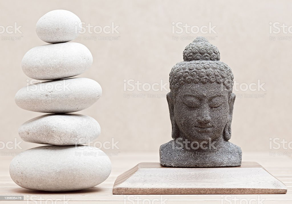 buddha statue beside stack of pebble stones royalty-free stock photo