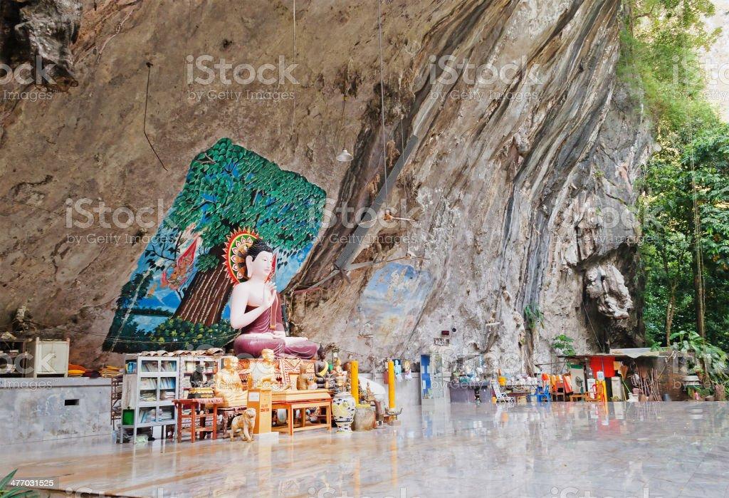 Buddha statue in a rock stock photo