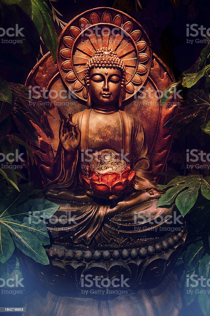 Buddha statue in calm serene setting royalty-free stock photo