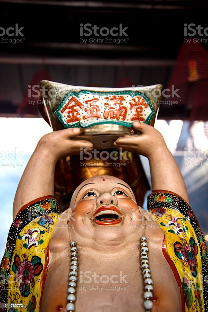 Buddha Statue in Chinese Temple Close Up of Face stock photo