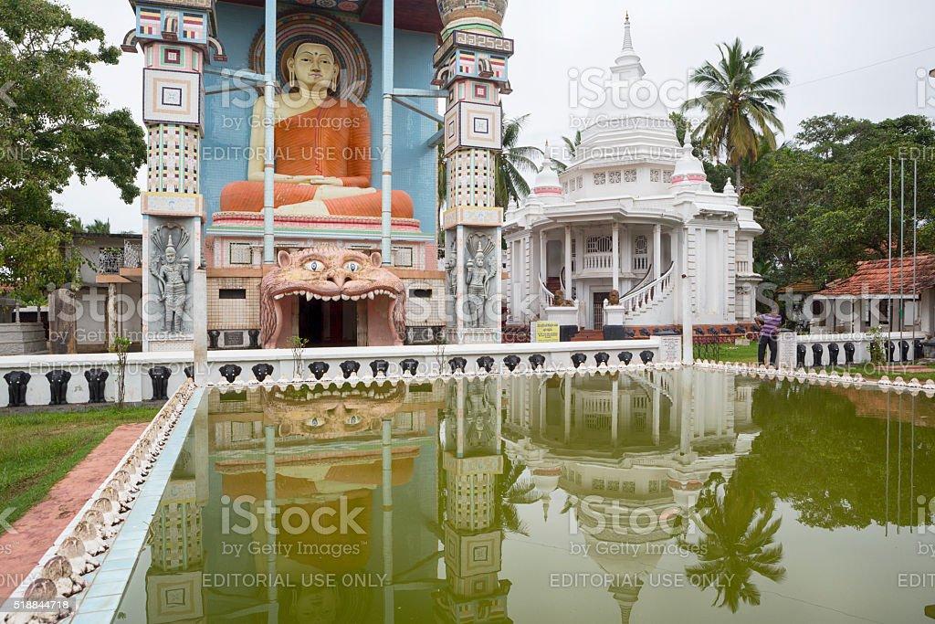Buddha Statue in front of Angurukaramulla Temple, Negombo, Sri Lanka stock photo