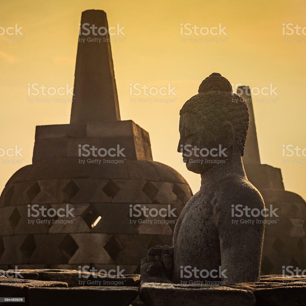 Buddha statue in open stupa in Borobudur temple stock photo