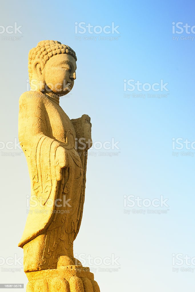 Buddha statue in the evening sun, lots of copy-space royalty-free stock photo