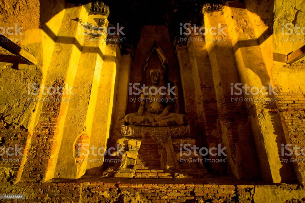 Buddha statue in the shadow stock photo
