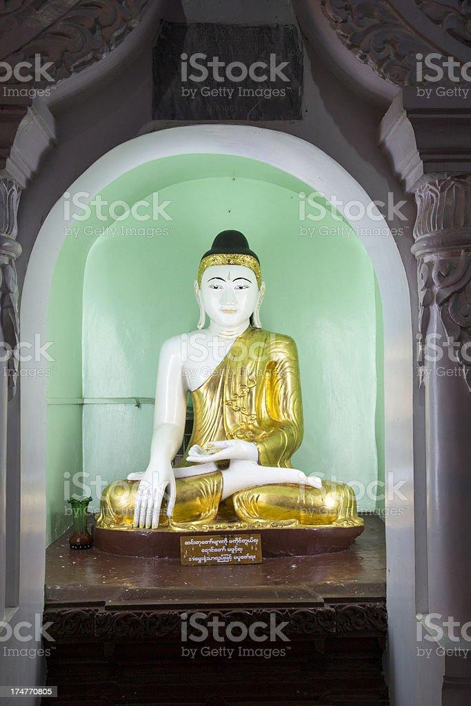 Buddha statue in the  Shwedagon Pagoda stock photo