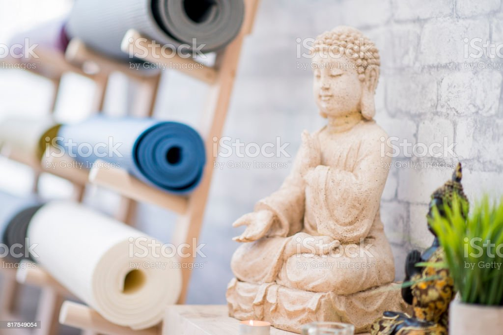 Buddha Statue in Yoga Studio stock photo