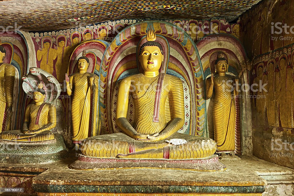 Buddha statue inside Dambulla cave temple, Sri Lanka stock photo