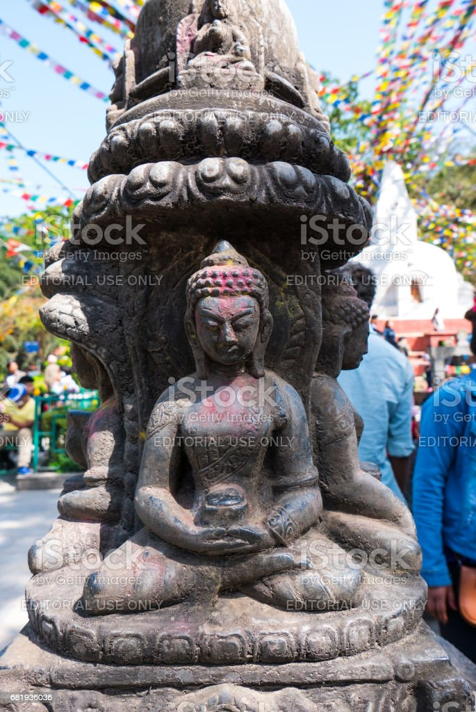 Buddha statue made out of stone stock photo