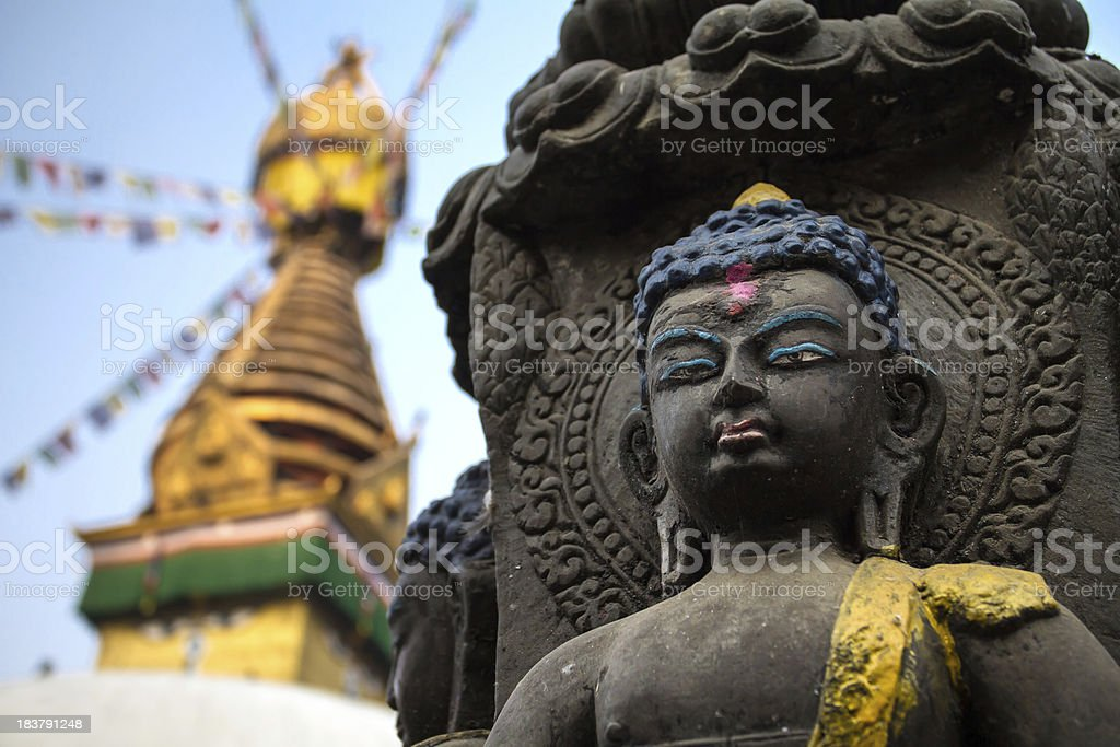 Buddha statue next to the Kathesimbhu Stupa in Kathmandu, Nepal stock photo