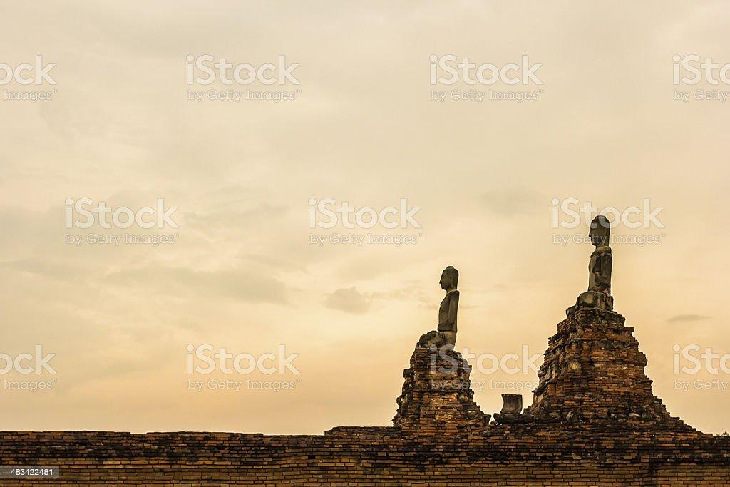 Buddha statue on sunset sky background stock photo