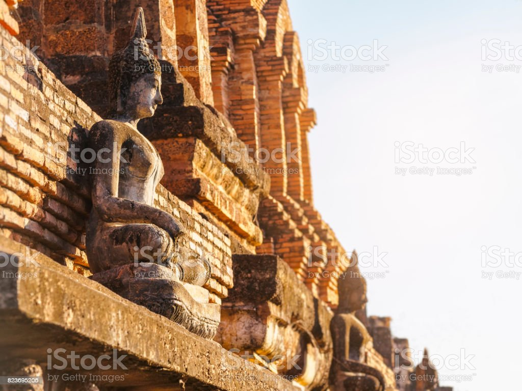 Buddha statue on temple wall in Sukhothai Historical Park World heritage Thailand stock photo