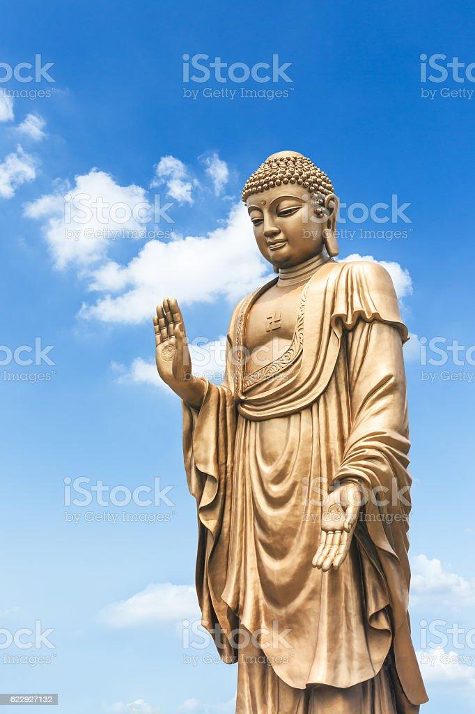 Buddha statue on the blue sky stock photo