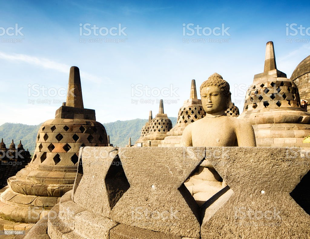 Buddha statue on top of Borobudur temple in Indonesia stock photo
