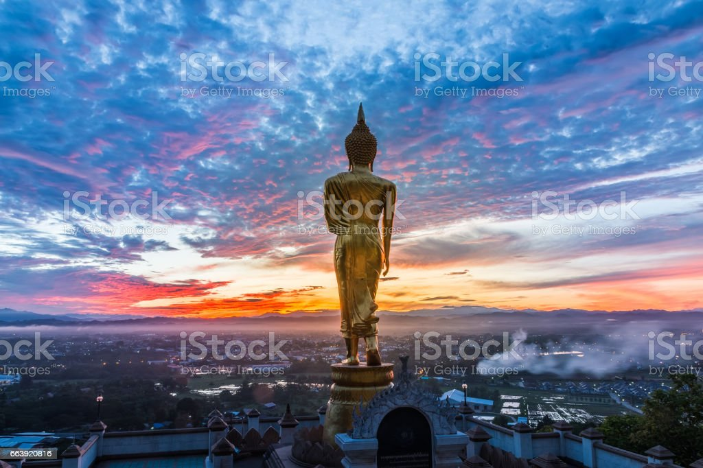 Buddha statue standing at Wat Phra That Khao Noi, Nan, stock photo