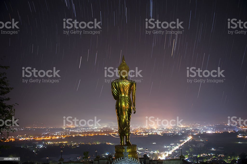 Buddha statue standing stock photo