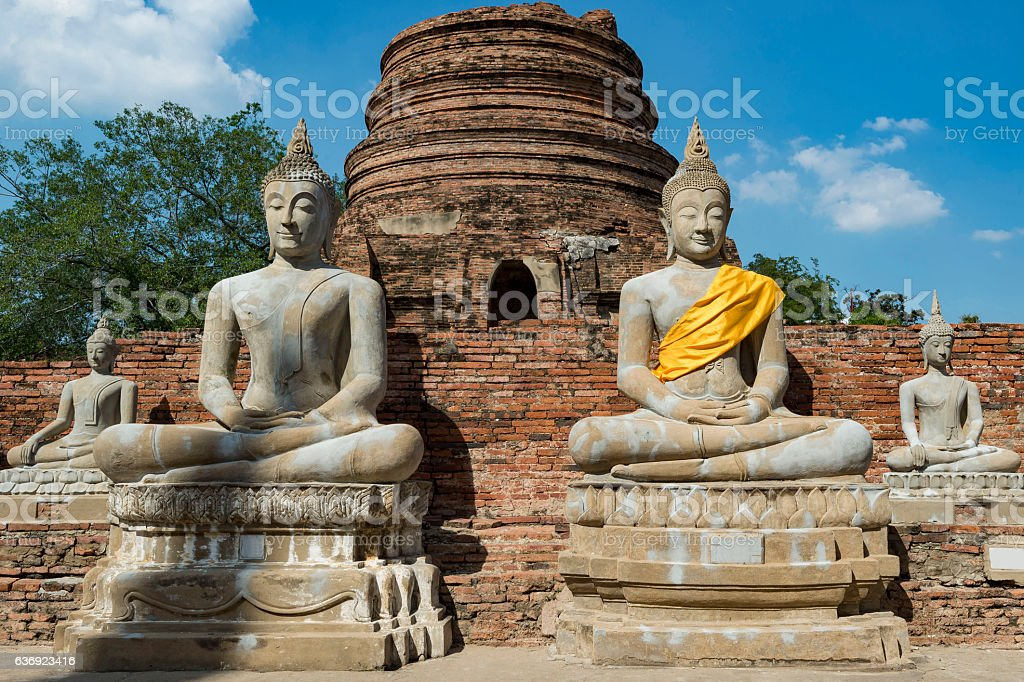 Buddha Statues around Chedi Chai Mongkhon Pagoda stock photo